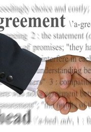 shaking hands over agreement