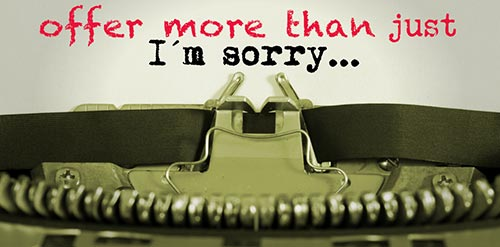 typewriter with I am sorry letter