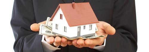 man holding house and money