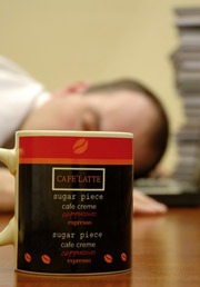 worker sleeping with coffee mug