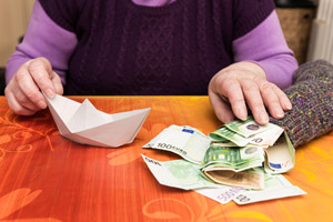paper boat and money in sock