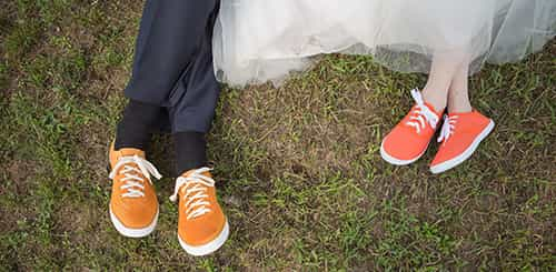 sneakers of young bride and groom