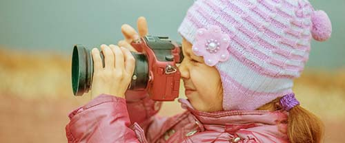 toddler with camera