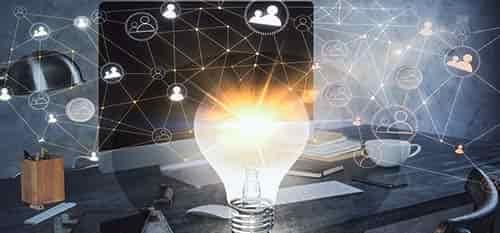 lightbulb and computer on desk