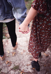 teen boy and girl holding hands