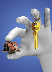 hand holding house and key