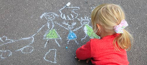 little girl chalk drawing