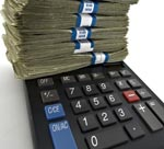 calculator with stack of money
