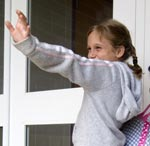 young girl waiving goodbye