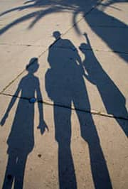 shadows of parent and two kids
