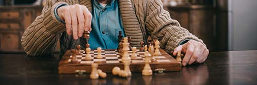 elderly person playing chess