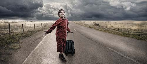 boy with travel bag