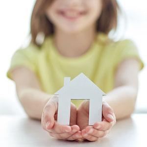 girl holding house
