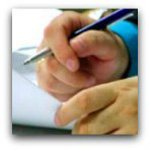 Hand with pen and document