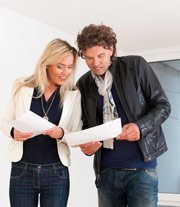 man and woman checking contract