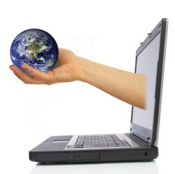 laptop with hand and globe