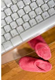 computer keyboard and slippers
