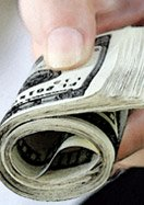 hand with money roll