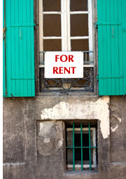 for rent sign on building