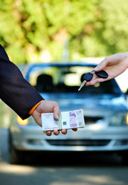 handing over money and car keys