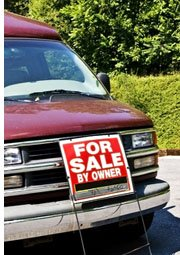 car with sign for sale by owner